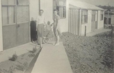 Denise and her mum and dad outside the prefab, Loughton, Essex