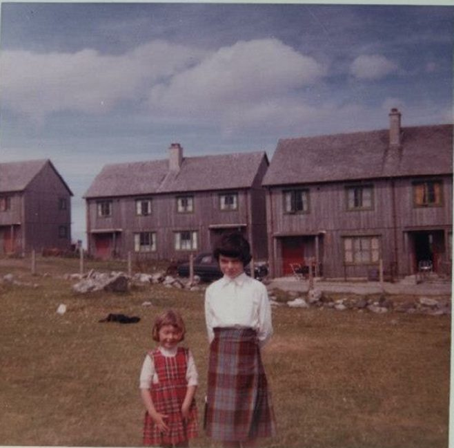 Joan and her sister. Swedish houses, Columba Place, Benbecula