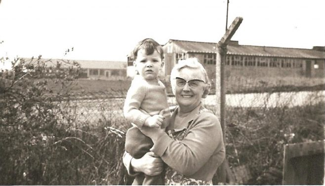 Alan with his grandmother Elizabeth Berriff in the garden of her prefab, Ascot Park, London