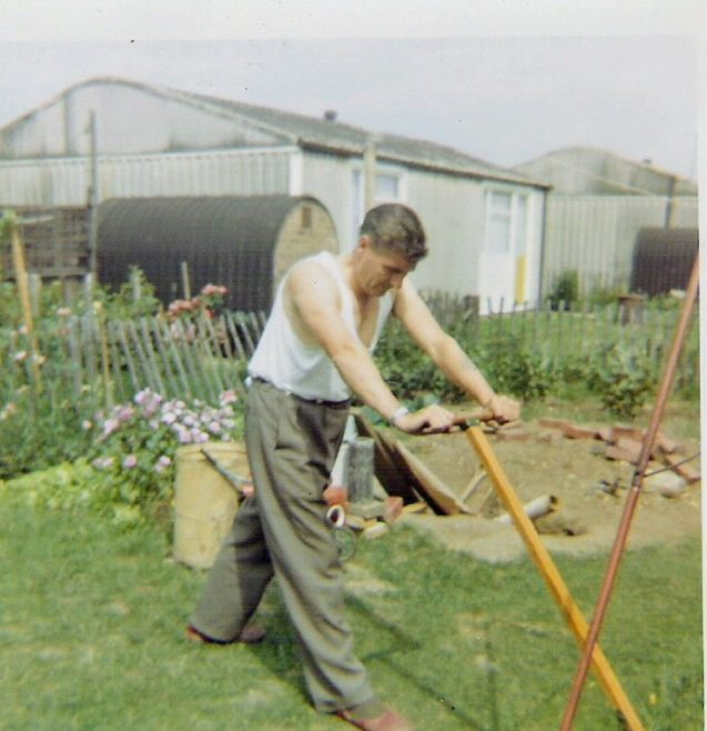 Dad mowing the lawn, 849 Ripple Road