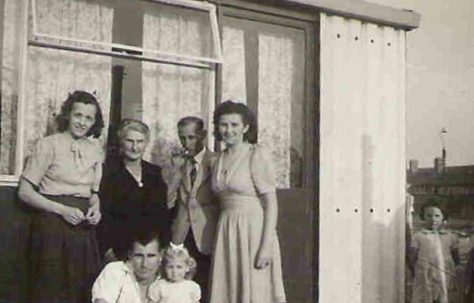 Graham's mother Ivy, his grandmother Amy Pope, her husband Albert and MaddiNieuwdorp. Front row Graham's father Robert and sister Roberta (aged 2). 849 Ripple Road