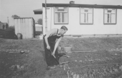 John's father, Ernest Quick, digging the back garden. Dark Lane Estate, 4 Holbrook Avenue, North Wingfield