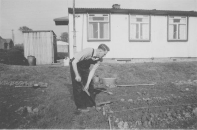 John's father, Ernest Quick, digging the back garden. Dark Lane Estate, 4 Holbrook Avenue, North Wingfield
