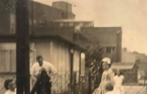Sue (with bow in her hair) and her mum and dad in the garden. Besson Street, London SE14