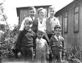 Cousin Mike left, my Mum then my brother Ernie. I am front left Roy Powell in the middle and Richard Davies right.