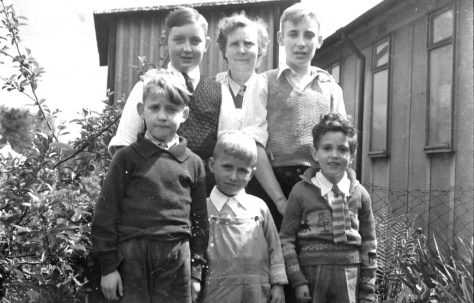 John's cousin Mike left, his Mum and brother Ernie. John is front left, Roy Powell in the middle and Richard Davies right. Reaston Street, London SE14