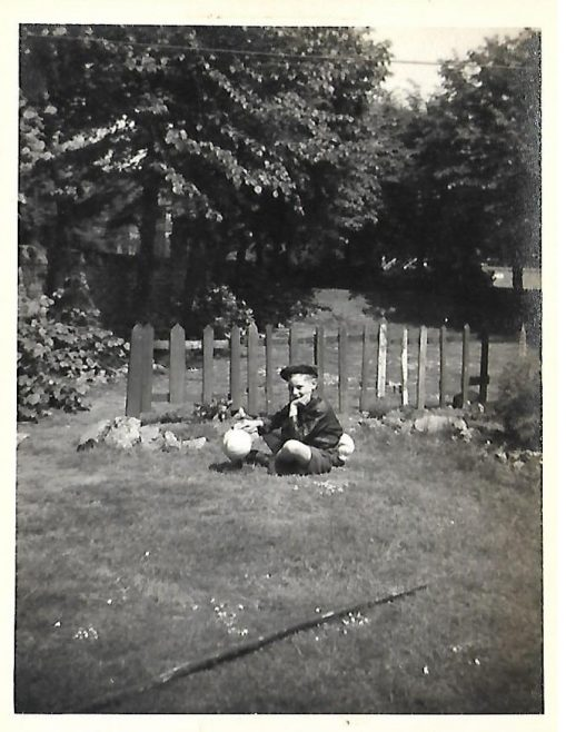 JOHN BUGG AGE 9 IN GARDEN OF 83b CARLETON ROAD. WHOLE GARDEN WAS OURS. 1956