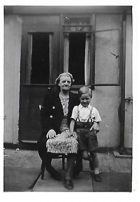 JOHN & GRANDMA FLORENCE BUGG OUTSIDE BACK DOOR OF 83b CARLETON RD 1952