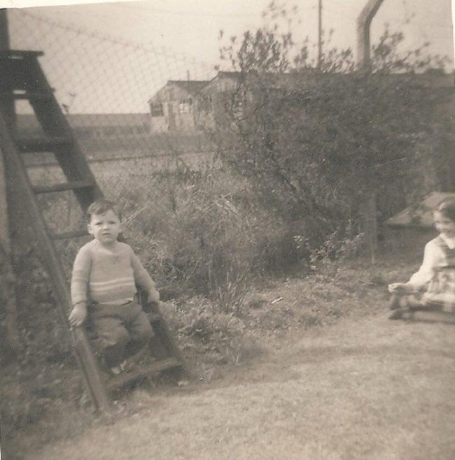 Alan on the stepladder with his sister. Ascot Park, Brent Cross, London