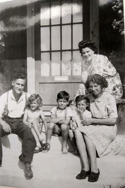 Three kids with Mum and Dad on the front porch. Swallow Street, Iver Heath, Buckinghamshire