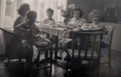 Family around the table. Swallow Street, Iver Heath, Buckinghamshire