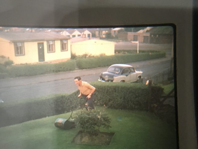 Dad mowing one of the front lawns