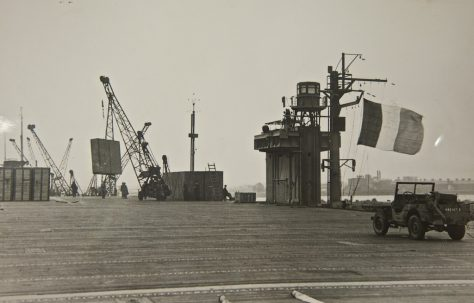 French Aircraft Carrier 'Dixmude' loading prefabs at Newport Docks, probably in 1946.