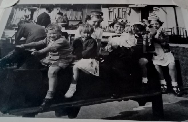 Children on rocking horse. Coronation Street party 1953. My brother Jim second from back. Limbourne Avenue, Dagenham | John Blake