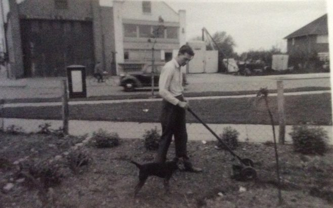 Arthur Mulley mowing the front garden with their dog Micky in Rochford Road, Southend | Polyanna