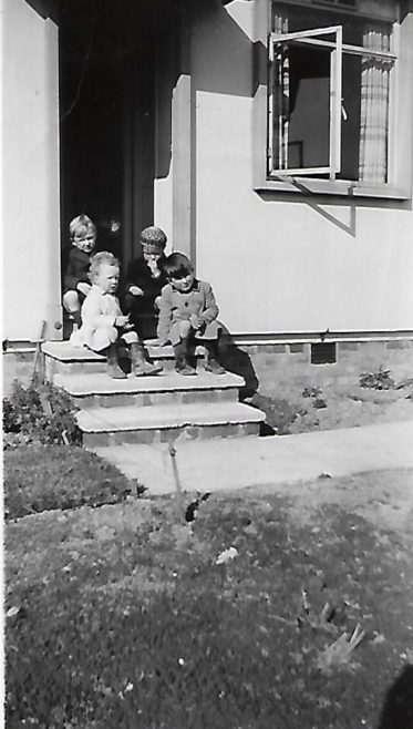 Pat (on the front at the right) and friends on the prefab steps, Douglas Road, Lenham | Pat Jessup