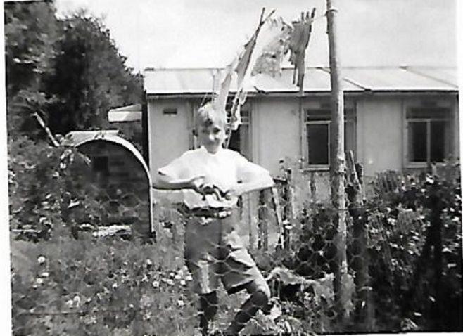 Pat's friend John in the prefab garden, Douglas Road, Lenham | Pat Jessup
