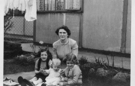 Christine, Robert and Pauline Flanders with their mum, Annie. 7 Hind Grove, Poplar, E.14. 1952