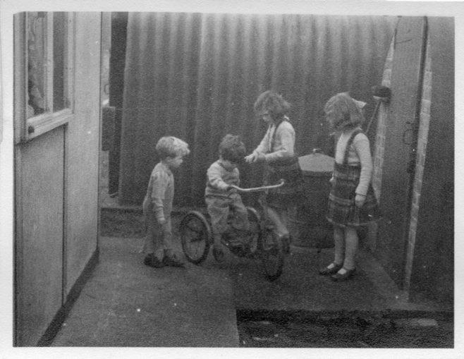 Twins Robert and David, Christine and Pauline Flanders. 7 Hind Grove, Poplar, E.14. 1954 | Robert Flanders
