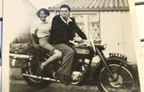 Outside our prefab, Uncle Alan impressing his girlfriend, soon to be wife, Sheila, on his Triumph Bonneville about 1955. 15 Bonchurch Road, Southampton