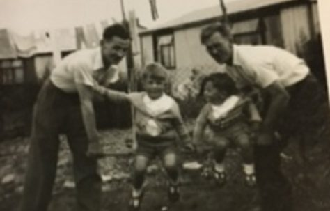 Two limbless ex servicemen who could only live in prefabs enjoy games with the kids 1955. 15 Bonchurch Road, Southampton