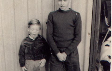 Nick and his brother outside the prefab, Roding Avenue, Barking