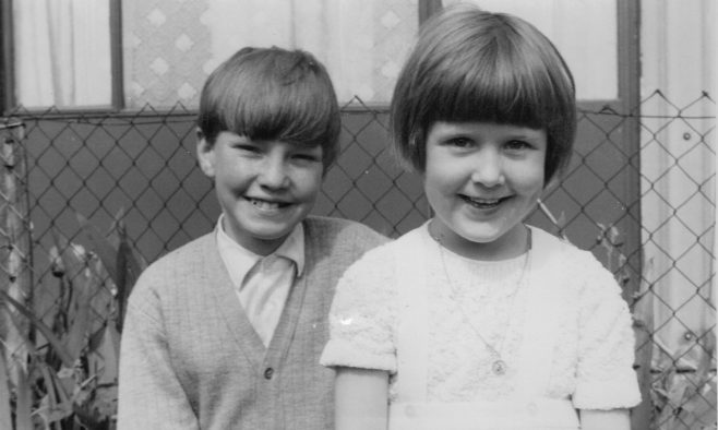 Nick Dowsett and cousin with No. 12 Roding Avenue, Barking in the background | Nick Dowsett