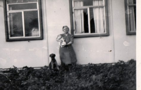 Winifred Arnold holding a baby (Roy Woollard) and a dog, plus dog sitting. 13 Mill Close, Ringmer