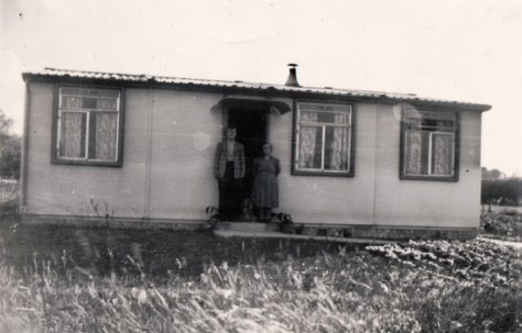 Albert and Winifred Arnold outside their prefab. 13 Mill Close, Ringmer