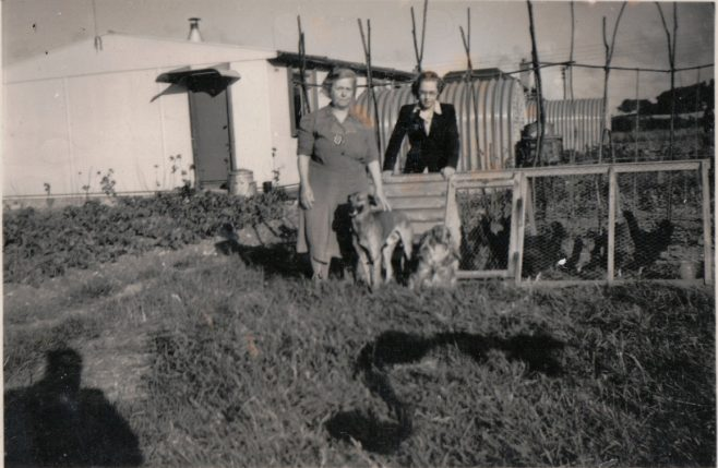 Winifred Arnold and daughter with dogs and chickens. 13 Mill Close, Ringmer | Kevin Arnold