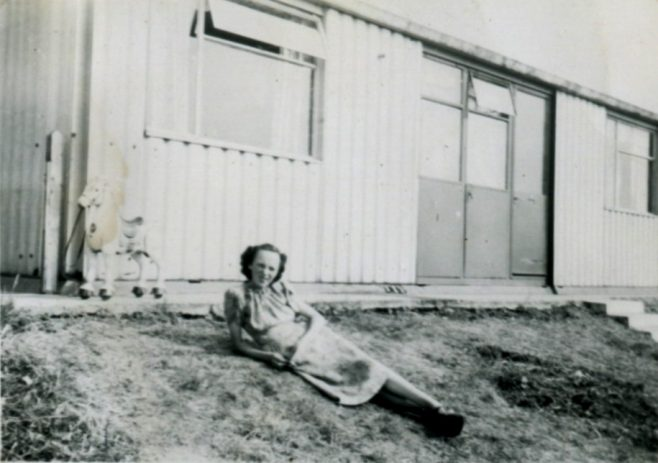 My mother relaxing outside our prefab. Llanelli Place, Fforestffach | Michael Mutton