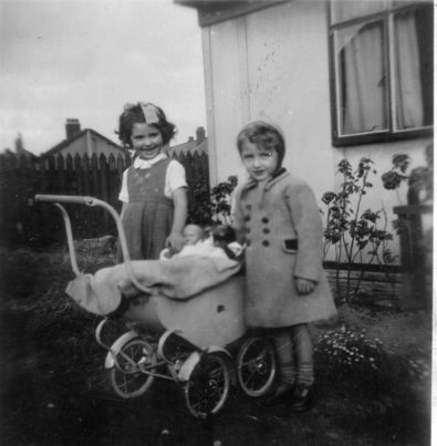 This is the only photo I can find of our condo in Patten Street, Birkenhead. I'm in the pram, though you can't see me (thankfully). This must be 1953.   John Winward